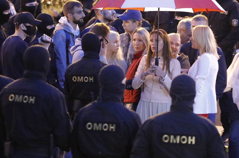 Police surround protesters during a Belarusian opposition supporters rally at Independence Square in Minsk, Belarus, Wednesday, Aug. 26, 2020. Protests demanding the resignation of Belarus' authoritarian President Alexander Lukashenko have entered their 18th straight day on Wednesday. (AP Photo/Dmitri Lovetsky)