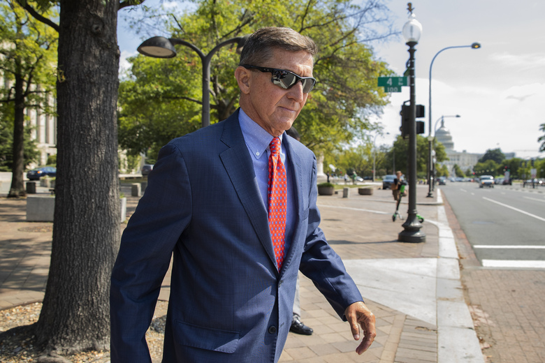 FILE – In this Sept. 10, 2019 file photo, Michael Flynn, President Donald Trump's former national security adviser, leaves the federal court following a status conference in Washington. The arrest of President Donald Trump's former chief strategist Steve Bannon adds to a growing list of Trump associates ensnared in legal trouble. They include the president's former campaign chair, Paul Manafort, whom Bannon replaced, his longtime lawyer, Michael Cohen, and his former national security adviser, Michael Flynn.  (AP Photo/Manuel Balce Ceneta, File)