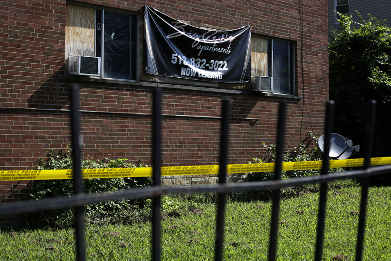 Police tape blocks off the front entrance of the Chalfonte Plaza apartment building at the scene of a shooting Chalfonte Place in the Avondale neighborhood of Cincinnati on Sunday, Aug. 16, 2020. Police in Cincinnati said multiple people were shot and several killed as gunfire erupted in several places around the city overnight. (Sam Greene/The Cincinnati Enquirer via AP)