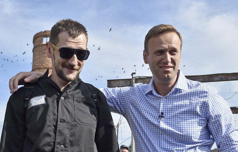 FILE – In this file photo taken on Friday, June 29, 2018, Russian opposition leader Alexei Navalny, right, poses for a photo with his brother Oleg Navalny, center, after Oleg's release from prison in Naryshkino, Orel region, 380 kilometers (237 miles) south of Moscow, Russia. (AP Photo/Dmitry Serebryakov)