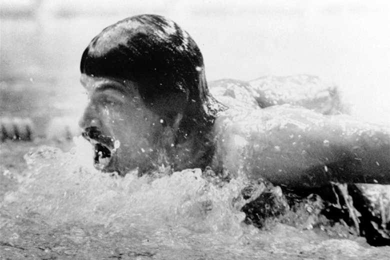 FILE – In this Sept. 4, 1972, file photo, American swimmer, Mark Spitz, competes in the butterfly segment of the 400-meter medley swimming event at the Summer Olympic swim hall in Munich, Germany. The American team placed first setting up a new world record in 3:48.16 min. (AP Photo/File)
