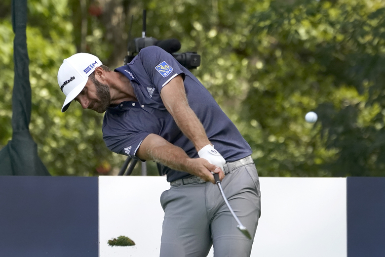 Dustin Johnson hits his tee shot on the 16th hole during the third round Saturday, Aug. 29, 2020, for the BMW Championship golf tournament at the Olympia Fields Country Club in Olympia Fields, Ill. Johnson and Hideki Matsuyama, of Japan, are tied for the lead at 1-under par after three rounds. (AP Photo/Charles Rex Arbogast)