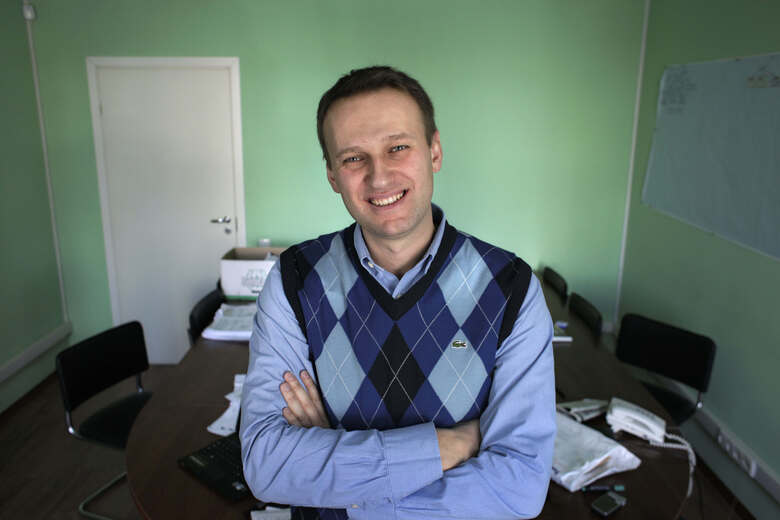 FILE – In this file photo taken on Wednesday, March 17, 2010, corporate Russian lawyer Alexei Navalny poses in his office in Moscow, Russia. (AP Photo/Alexander Zemlianichenko, File)