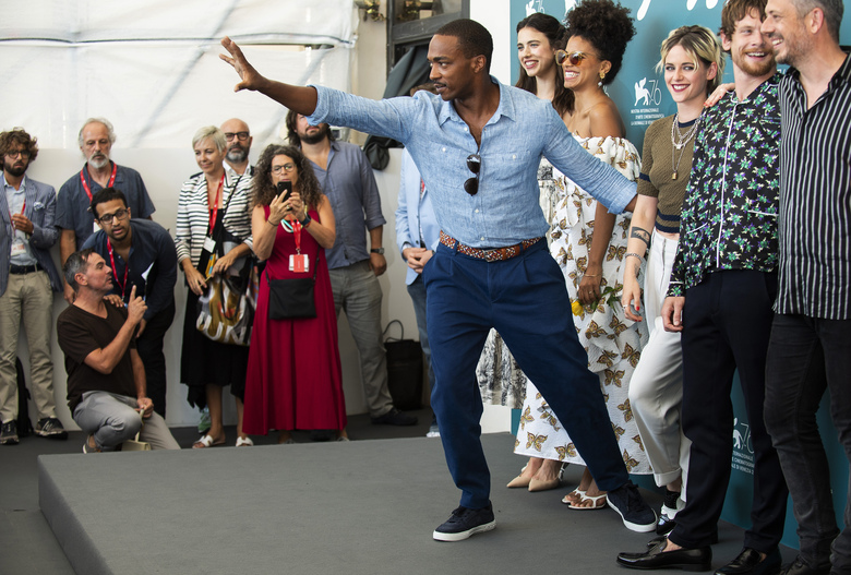File – Actor Anthony Mackie gestures to photographers at the photo call for the film 'Seberg' at the Venice Film Festival. The 77th Venice Film Festival will kick off on Wednesday, Sept. 2, 2020, but this year's edition will be unlike any others. Coronavirus restrictions will mean fewer Hollywood stars, no crowds interacting with actors and other virus safeguards will be deployed. (Photo by Arthur Mola/Invision/AP, File)