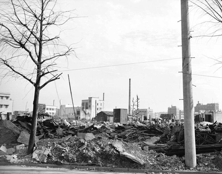 FILE – This Sept. 1, 1945, file photo shows destroyed business buildings in the city of Yokohama, near Tokyo. U.S. B-29's bombing raids left ruins debris and destruction near the American Consulate. The bombs stopped falling 75 years ago, but it is entirely possible – crucial even, some argue – to view the region's world-beating economies, its massive cultural and political reach and its bitter trade, territory and history disputes all through a single prism: Japan's aggression in the Pacific during World War II. (AP Photo/Frank Filan, Pool, File)