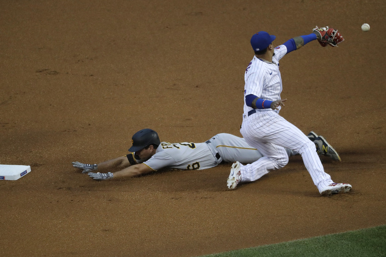 Pittsburgh Pirates' Adam Frazier, left, is safe at second after hitting a double as Chicago Cubs shortstop Javier Baez misses the catch during the first inning of a baseball game in Chicago, Saturday, Aug. 1, 2020. (AP Photo/Nam Y. Huh)