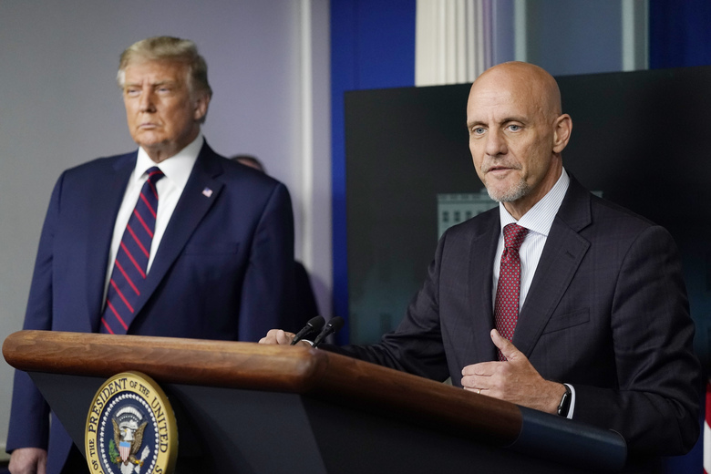 FDA commissioner Dr. Stephen Hahn, shown with President Donald Trump on Sunday, has walked back some of his remarks on the effectiveness of using convalescent plasma from COVID-19 survivors. (AP Photo/Alex Brandon)