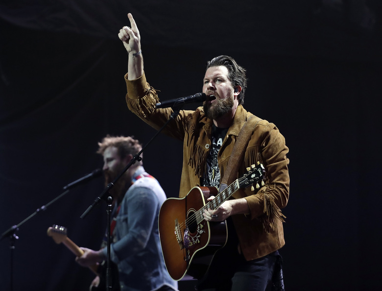 FILE – This Oct. 16, 2018 file photo shows Zach Williams performing during the Dove Awards in Nashville, Tenn.  Christian artists Zach Williams and for King & Country are the leading artist nominees at the 2020 Dove Awards, while rapper Kanye West and singer Gloria Gaynor earned their first ever nominations.(AP Photo/Mark Humphrey, File)