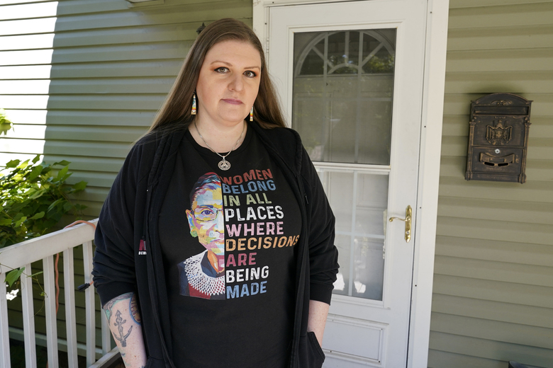 Melissa Mays is photographed outside her home in Flint, Mich., Thursday, Aug. 20, 2020. Mays sued the state on behalf her three sons, saying they have had medical and educational difficulties because of lead exposure in the Flint water system. Michigan Gov. Gretchen Whitmer says a proposed $600 million deal between the state of Michigan and Flint residents harmed by lead-tainted water is a step toward making amends. Officials announced the settlement Thursday, which must be approved by a federal judge. (AP Photo/Carlos Osorio)