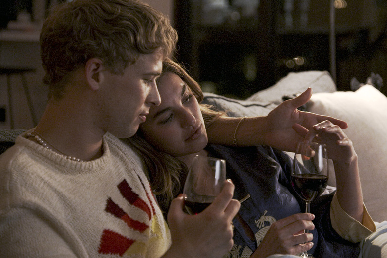 """This image released by Freeform shows Tommy Dorfman, left, and Rainey Qualley in a scene from """"Love in the Time of Corona,"""" a two-part series airing Aug.22-23 on Freeform. (Freeform via AP)"""