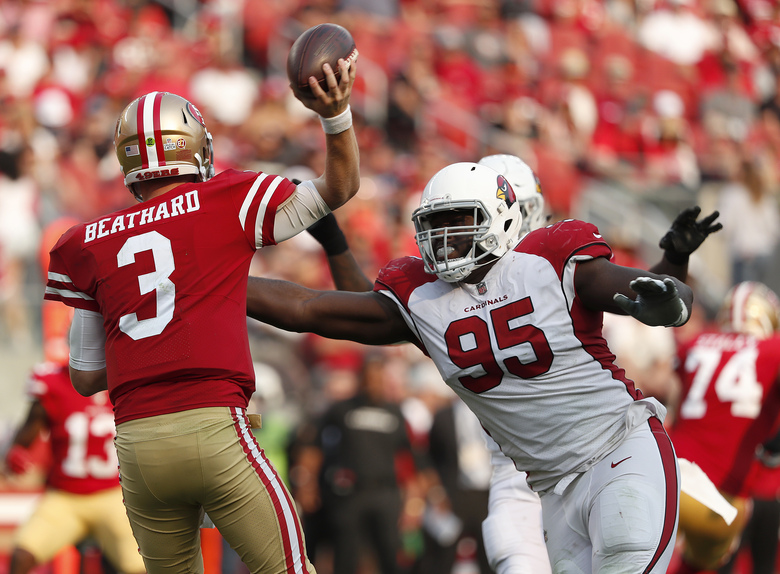 FILE – In this Oct. 7, 2018, file photo, Arizona Cardinals defensive tackle Rodney Gunter (95) pressures San Francisco 49ers quarterback C.J. Beathard (3) during the second half of an NFL football game in Santa Clara, Calif. Gunter, who signed as a free agent in March with the Jacksonville Jaguars, is stepping away from football because of an enlarged aorta. Gunter, who had been placed on the team's non-football injury list at the start of training camp, dropped the news in a statement Sunday, Aug. 16, 2020. (AP Photo/Tony Avelar, File)
