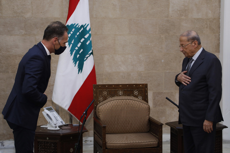 """In this photo released by Lebanon's official government photographer Dalati Nohra, Lebanese president Michel Aoun, right, meets with German Foreign Minister Heiko Maas, at the Presidential Palace in Baabda, east of Beirut, Lebanon, Wednesday, Aug. 12, 2020. Maas said that Lebanon needs a """"strong reboot"""" and far-reaching economic reforms to rebuild trust with its citizens. Heiko Maas spoke ahead of his trip to Beirut, following last week's explosion at the city's port that killed at least 171 people and wounded thousands. (Dalati Nohra via AP)"""