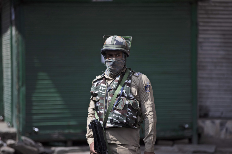 """A paramilitary soldier stands guard during curfew in Srinagar, Indian controlled Kashmir, Tuesday, Aug. 4, 2020. Authorities clamped a curfew in many parts of Indian-controlled Kashmir on Tuesday, a day ahead of the first anniversary of India's controversial decision to revoke the disputed region's semi-autonomy. Shahid Iqbal Choudhary, a civil administrator, said the security lockdown was clamped in the region's main city of Srinagar in view of information about protests planned by anti-India groups to mark Aug. 5 as """"black day."""" (AP Photo/Mukhtar Khan)"""