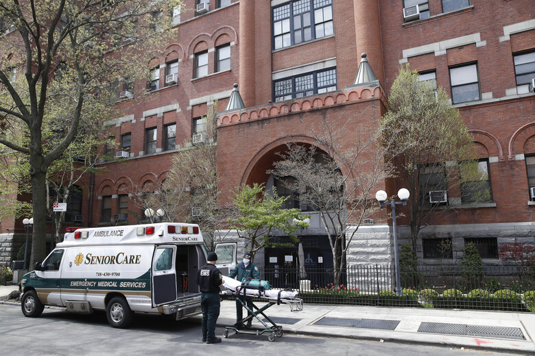 FILE – In this April 17, 2020, file photo, emergency medical workers arrive at Cobble Hill Health Center in the Brooklyn borough of New York. New York Gov. Andrew Cuomo responded Wednesday, Aug. 19, 2020, to an Associated Press report that his state's coronavirus death toll in nursing homes could be a major undercount, saying it makes sense to include only those residents who died on the home's property. (AP Photo/John Minchillo, File)