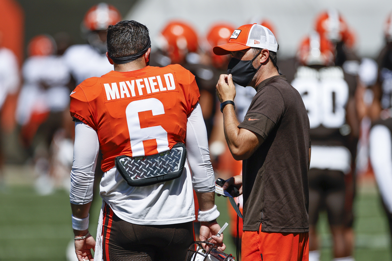 Cleveland Browns head coach Kevin Stefanski, right, talks with quarterback Baker Mayfield, left, during practice at the NFL football team's training facility Wednesday, Aug. 19, 2020, in Berea, Ohio. (AP Photo/Ron Schwane)