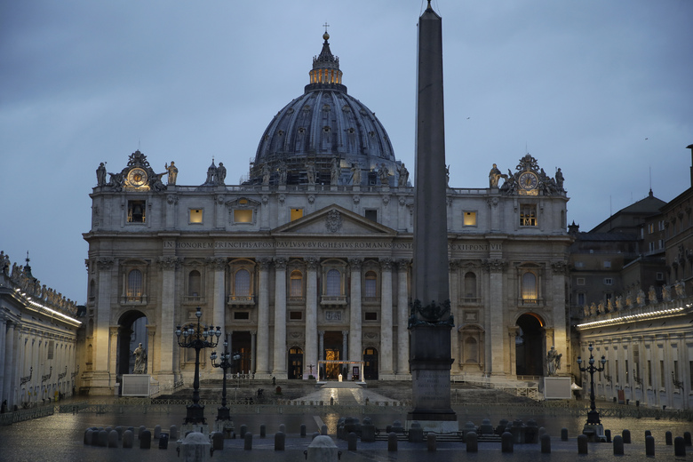 FILE – In this file photo taken on March 27, 2020, Pope Francis delivers the Urbi and Orbi prayer in an empty St. Peter's Square, at the Vatican. If ever there was a defining moment of Pope Francis during the coronavirus pandemic, it came on March 27, the day Italy recorded its single biggest daily jump in fatalities. From the rain-slicked promenade of St. Peter's Basilica, Francis said the virus had shown that we're all in this together, that we need each other and need to reassess our priorities. (AP Photo/Alessandra Tarantino, File)