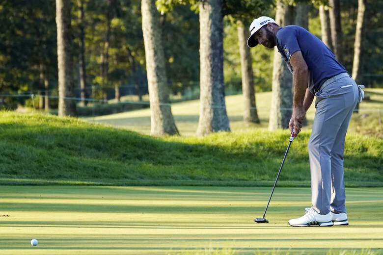 Dustin Johnson watches his birdie putt on the 17th hole during the third round of the Northern Trust golf tournament at TPC Boston, Saturday, Aug. 22, 2020, in Norton, Mass. (AP Photo/Charles Krupa)