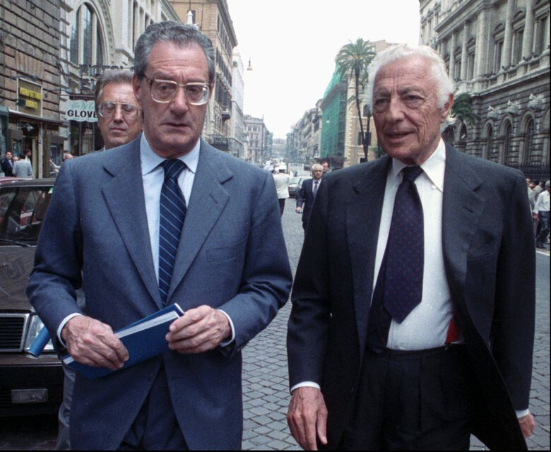 FILE — May 31, 1988 file photo of Gianni Agnelli, right, chairman of Italy's auto giant FIAT, and chief operating officer Cesare Romiti, as they leave the Banca d'Italia (Bankitalia)in Rome. Romiti has died Tuesday, Aug. 18, 2020, in his house in Milan at the age of 97, according to Italian media. (AP Photo/Gianni Foggia, file)
