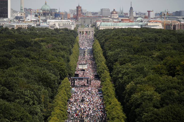 People gather at the Brandenburg gate for a demonstration with the slogan 'The end of the pandemic – freedom day' – against coronavirus restrictions in Berlin, Germany, Saturday, Aug. 1, 2020. It comes amid increasing concern about an upturn in infections in Germany. (AP Photo/Markus Schreiber)