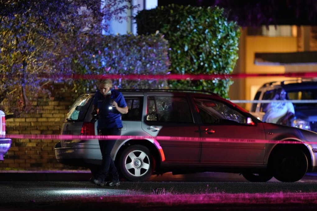 An investigator works at a scene where a man suspected of fatally shooting a supporter of a right-wing group in Portland on Saturday was killed as investigators moved in to arrest him in Lacey, Thurston County,  on Thursday night. (Ted Warren / Associated Press)