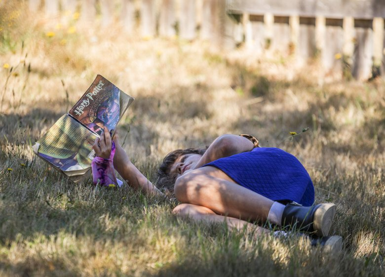 Thursday, Sept. 3, 2020   Student Molly O'Dell, 10, reading in her outdoor classroom in the 4-6th grade class at Swan School.    (Steve Ringman / The Seattle Times)