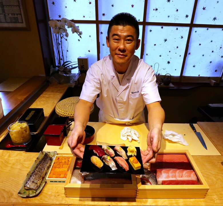 Sushi chef Kotaro Kumita has been charged with assault and extortion after an employee alleged that he was beaten repeatedly while working for Kumita.  (Greg Gilbert / The Seattle Times)