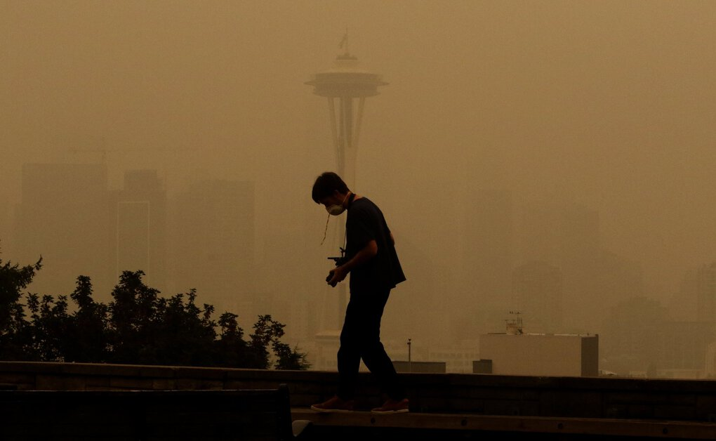 The Space Needle was barely visible from Kerry Park on Saturday. (Alan Berner / The Seattle Times)