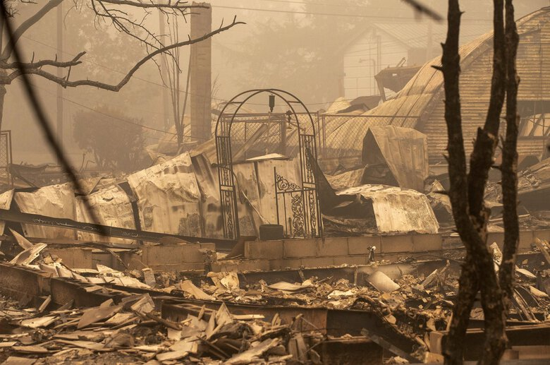 Only debris remains of several homes that were destroyed by the Beachie Creek fire east of Salem, Oregon, on Sunday.  (Rob Schumacher / The Associated Press)