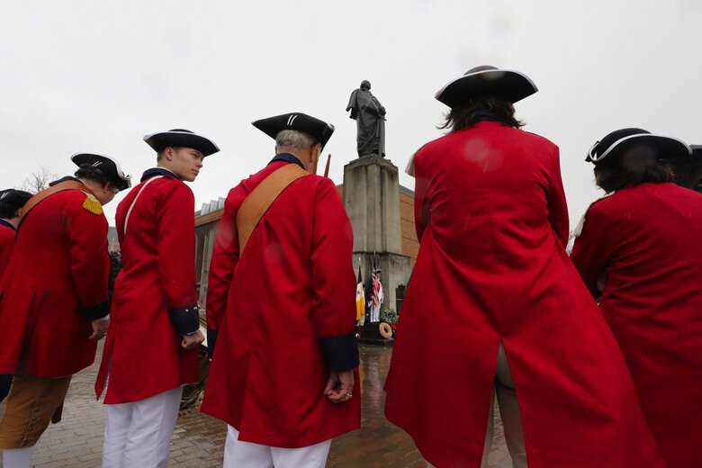 Members of the Washington Society of the Sons of the American Revolution fife and drum corps and color guard  form up at the statue of George Washington on the University of Washington campus for a wreath-laying ceremony on President's Day 2019. (Alan Berner / The Seattle Times, 2019)