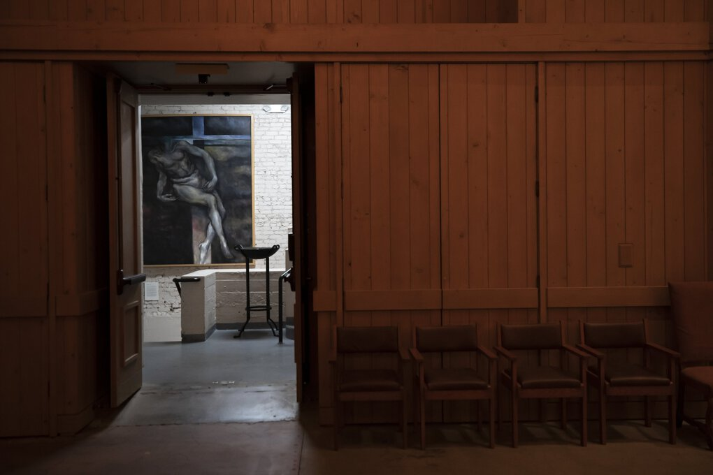 """Art and architecture come alive in the walls of the mostly empty cathedral. This work is """"Descent from the Cross,"""" by artist Jeff Hengst. (Bettina Hansen / The Seattle Times)"""