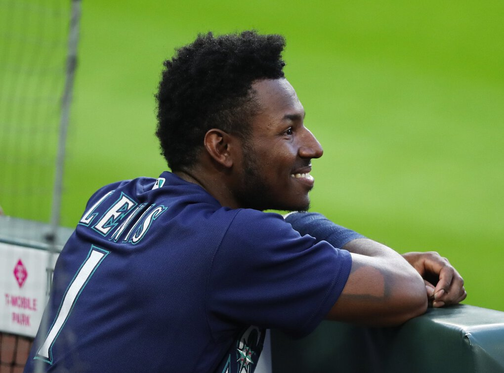 Mariners center fielder Kyle Lewis looks out from the dugout during a game on Sept. 21. (Ken Lambert / The Seattle Times)