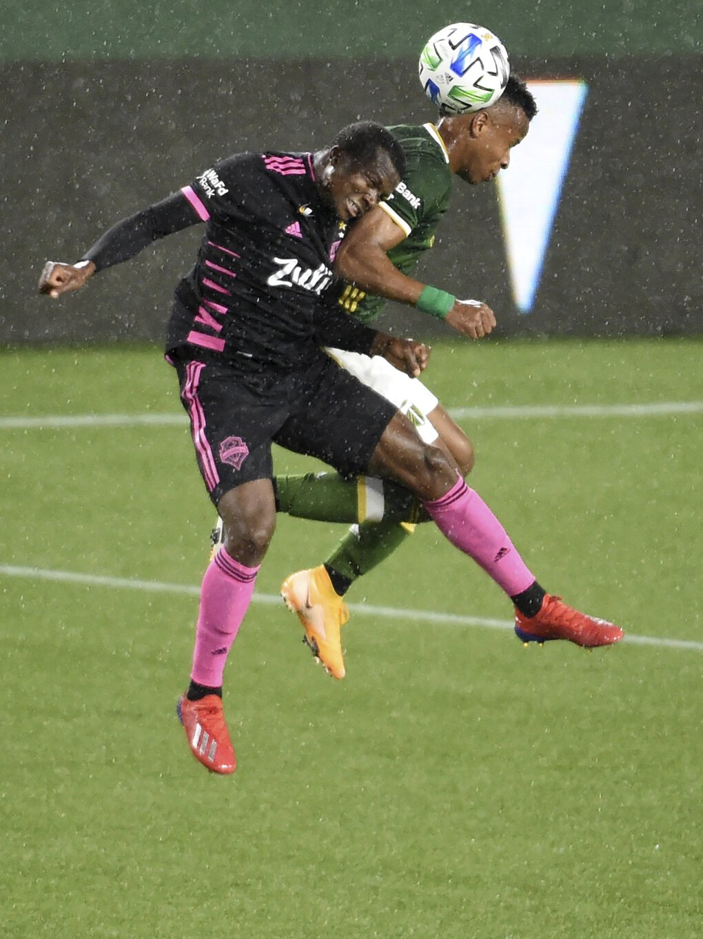 Seattle Sounders defender Nouhou Tolo, and Portland Timbers forward Jeremy Ebobisse go up for a header during the first half in Portland on Wednesday. (Steve Dykes / Associated Press)