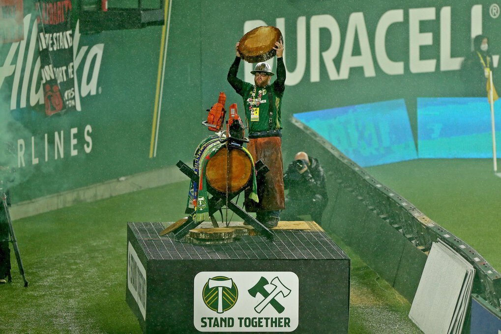 """""""Timber Jim"""" celebrates cutting a log at Providence Park in Portland. (Sean Meagher / The Oregonian)"""