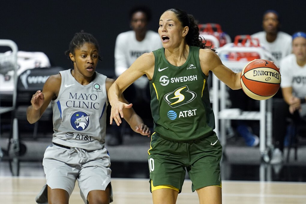 Sue Bird scans the court as she drives around Crystal Dangerfield during the second half. (Chris O'Meara / Associated Press)