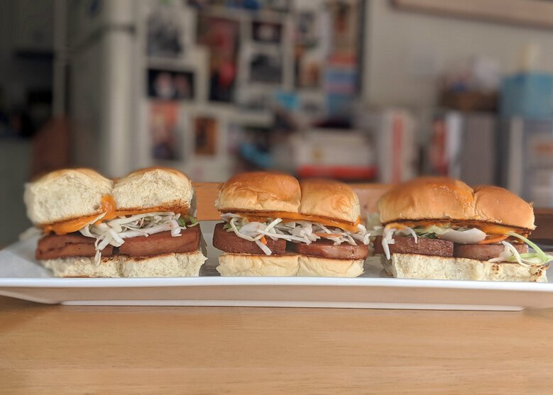 Reheat everything from kalua pork to Spam sliders just in time for kickoff from Marination and Super Six. (Jackie Varriano / The Seattle Times)