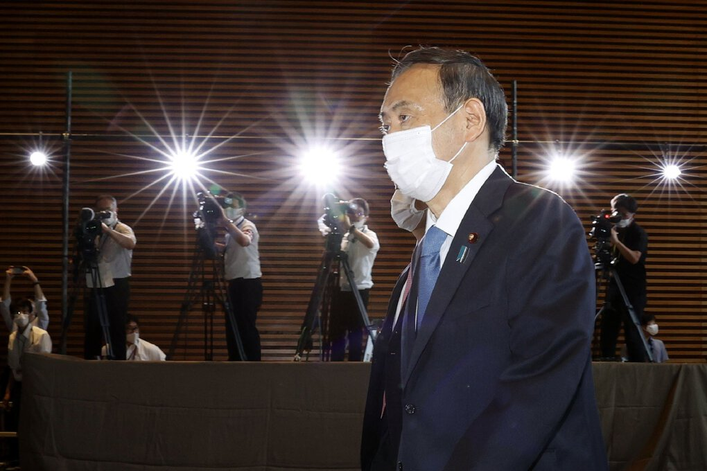 Yoshihide Suga arrives at the prime minister's office after formally being elected Japan's prime minister in a parliamentary vote  Wednesday. (Shinji Kita / The Associated Press)