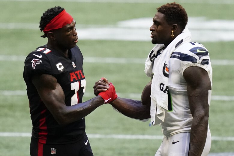 Falcons wide receiver Julio Jones and Seahawks wide receiver DK Metcalf speak after Sunday's game in Atlanta. (Brynn Anderson / The Associated Press)