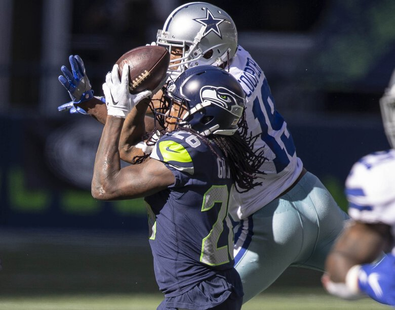 Shaquill Griffin pulls down the interception late in the 2nd quarter that would lead to a Seahawks touchdown.  The Dallas Cowboys played the Seattle Seahawks in NFL Football Sunday, September 27, 2020 at CenturyLink Field in Seattle, WA. (Dean Rutz / The Seattle Times)
