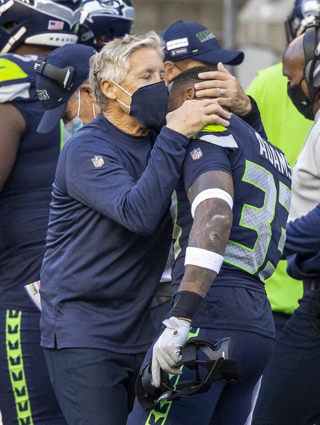 Pete Carroll grabs safety Jamal Adams after the Seahawks intercepted Dak Prescott on the Cowboys final play of the game to win 38-31 on Sunday at CenturyLink Field. (Dean Rutz / The Seattle Times)