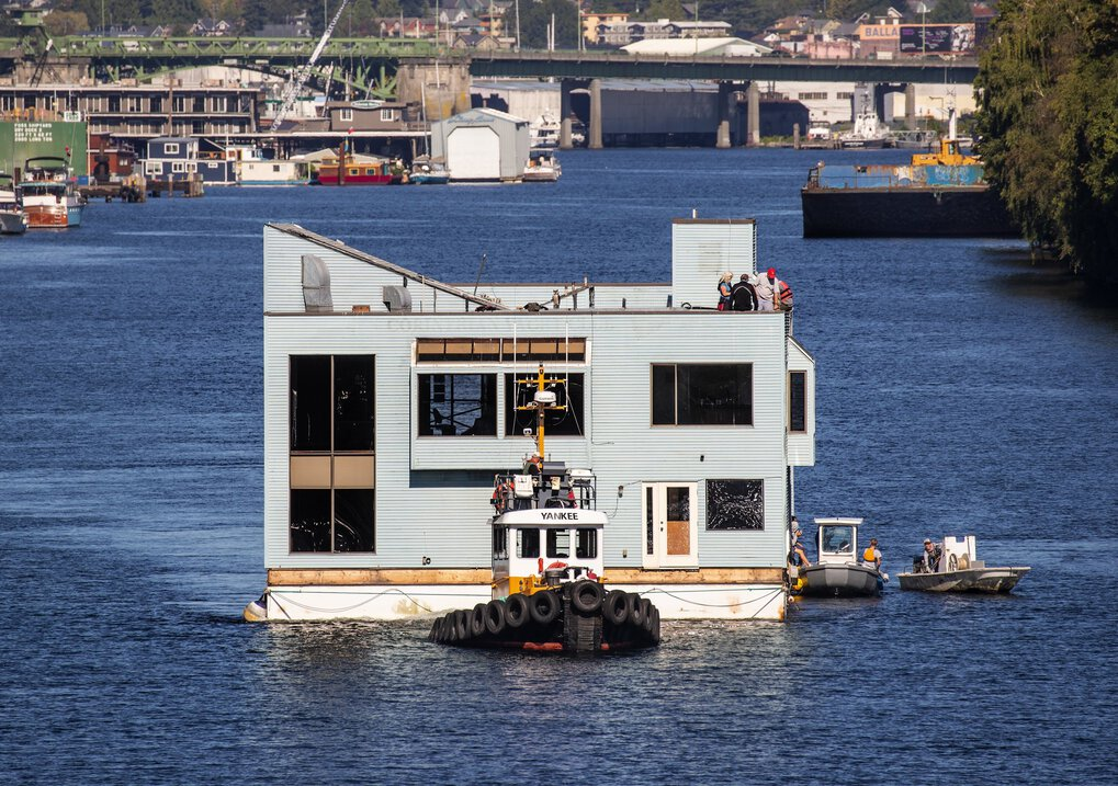 The Corinthian Yacht Club of Seattle's floating clubhouse makes its way via tugboat through the Fremont Cut to the Lake Union Drydock Tuesday. The 50-year old floating clubhouse will spend three months at the drydock for a $500,000 repair and remodeling project.  (Mike Siegel / The Seattle Times)