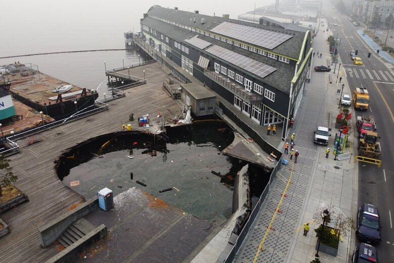 The partial collapse of Pier 58 viewed from the air Sunday at Seattle's waterfront. In the background is the Seattle Aquarium. (Ken Lambert / The Seattle Times)