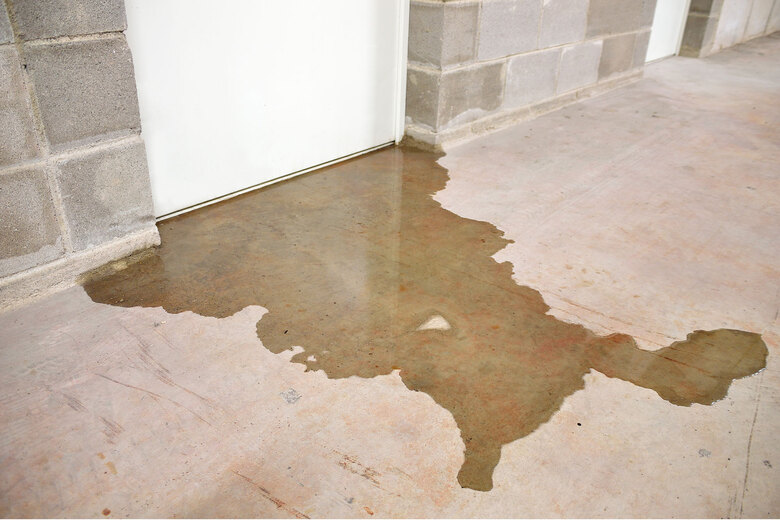 Need to solve a basement leak? Before you shell out for an expensive sump pump, be sure to check your yard and foundation. (Getty Images)