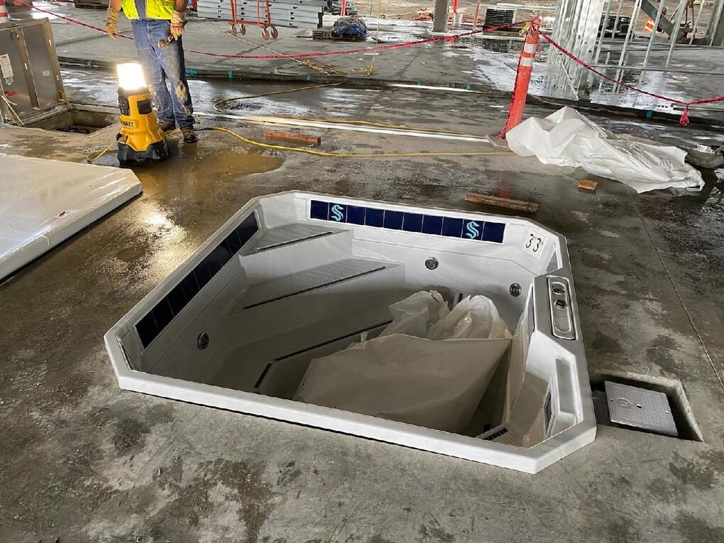 A hot tub with Kraken logo at the new training facility at Northgate Mall. (Courtesy of Kraken)