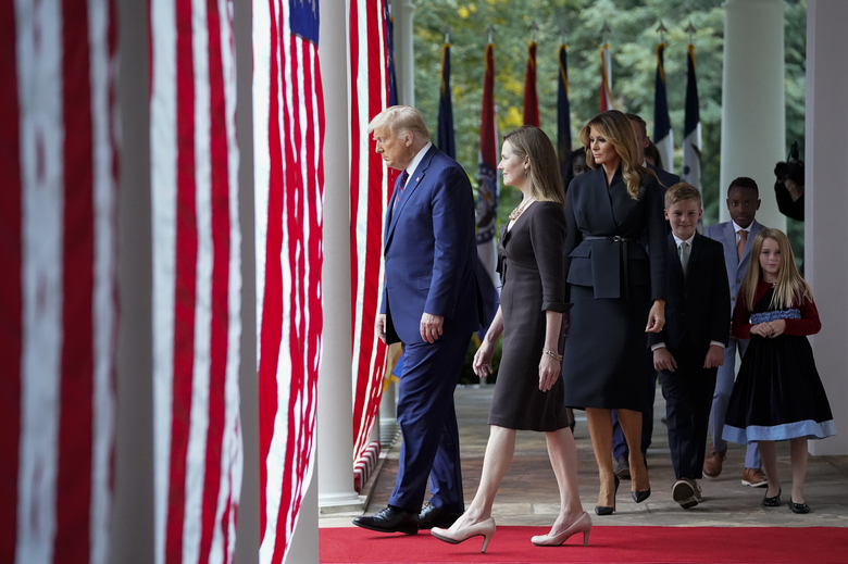 President Donald Trump and Judge Amy Coney Barrett walk out as the president readies to announce her nomination to the Supreme Court at the White House, Saturday, Sept. 26, 2020. (Jabin Botsford / Washington Post).