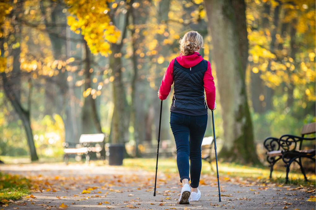 Switch up your fitness routine by going for a walk with Nordic poles. (Getty Images)