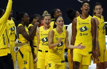 The Seattle Storm celebrate after the team defeated the Minnesota Lynx during Game 3 of a WNBA basketball semifinal round playoff series Sunday, Sept. 27, 2020, in Bradenton, Fla. The Storm move onto the WNBA finals. (AP Photo/Chris O'Meara) FLCO156 FLCO156