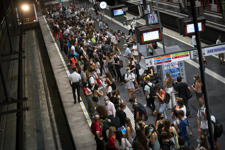 Students wait for the train to go to university, during a precise moment of rush hour in Barcelona, Spain, Thursday, Sept. 17, 2020. (AP Photo/Emilio Morenatti)