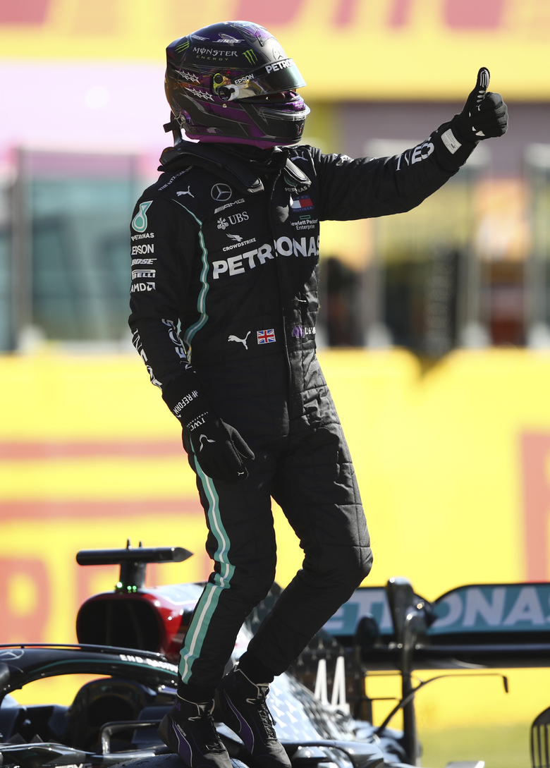 Mercedes driver Lewis Hamilton of Britain gets out of his car and gives the thumbs up after clocking the best time during qualification ahead of the Grand Prix of Tuscany, at the Mugello circuit in Scarperia, Italy, Saturday, Sept. 12, 2020. Hamilton will take pole position for the Formula One Grand Prix of Tuscany on Sunday. (Bryn Lennon, Pool via AP)