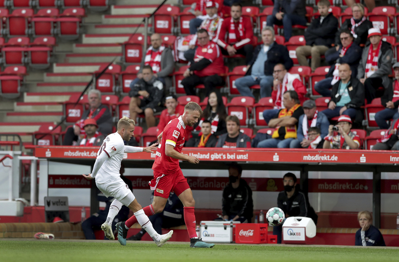 Nuremberg's Pascal Koepke, left, and Union's Marvin Friedrich, right, challenge for the ball during a friendly soccer match between the German first division, Bundesliga, team 1. FC Union Berlin and the second division team 1. FC Nuremberg in Berlin, Germany, Saturday, Sept. 5, 2020. (AP Photo/Michael Sohn)