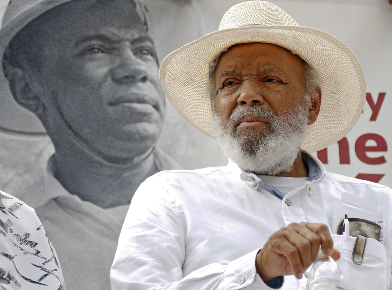 """FILE- In this June 26, 2016, photo, civil rights activist James Meredith sits in front of a 1966 photograph of himself during a commemoration of the 50th anniversary of his 1966 March Against Fear at the Capitol in Jackson, Miss. """"Walk Against Fear: James Meredith,"""" scheduled to air Thursday, Oct. 1, 2020, on the Smithsonian Channel, examines the life of a U.S. Air Force veteran-turn-human right agitator whose admission into the University of Mississippi forced President John F. Kennedy to send federal troops into the state to quell a white supremacy uprising. It was one of the most violent moments of the Civil Rights Movement and it forever changed life in the American Deep South. (AP Photo/Rogelio V. Solis, File)"""